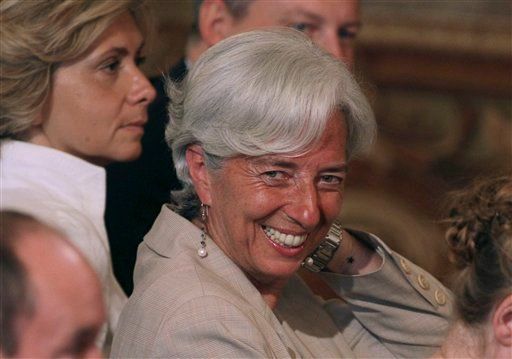 France's Finance Minister Christine Lagarde, smiles during a press conference of France's President Nicolas Sarkozy at the Elysee Palace, Paris Monday, June 27, 2011. (AP Photo/Michel Euler)