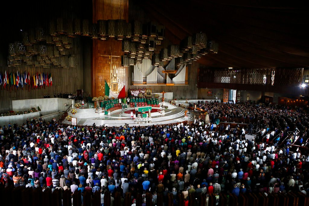 People attend a Mass remembering the victims of the recent 7.1-magnitude earthquake, at the Basilica of Guadalupe, in Mexico City, Sunday, Sept. 24, 2017. (AP Photo/Rebecca Blackwell)