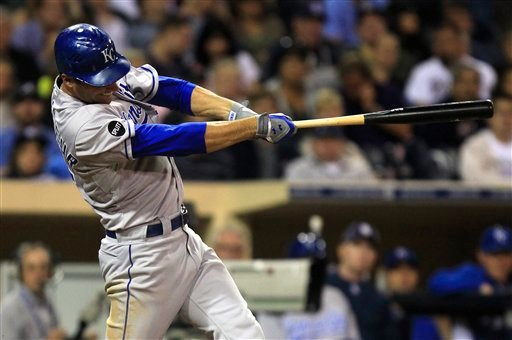 Kansas City Royals' Jeff Francoeur swings on a solo home run against the San Diego Padres in the seventh inning of a baseball game Tuesday, June 28, 2011, in San Diego. (AP Photo/Lenny Ignelzi)