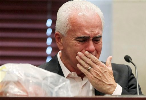 George Anthony reacts during his testimony in the murder trial of his daughter, Casey, in Orlando, Fla., Wednesday, June 29, 2011.