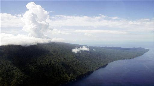 Steam billows from Lake Vui in the volcano crater of Mount Manaro on the island of Ambae, part of the Vanuatu islands chain, Thursday, Dec. 8, 2005. (AP Photo/Rick Rycroft)