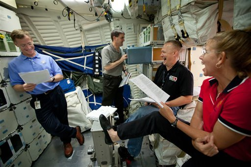 In this Wednesday, June 29, 2011 photo, the crew of STS-135 reviews procedures on the mid-deck of the Crew Compartment Trainer (CCT) II mockup as they train at the Johnson Space Center,