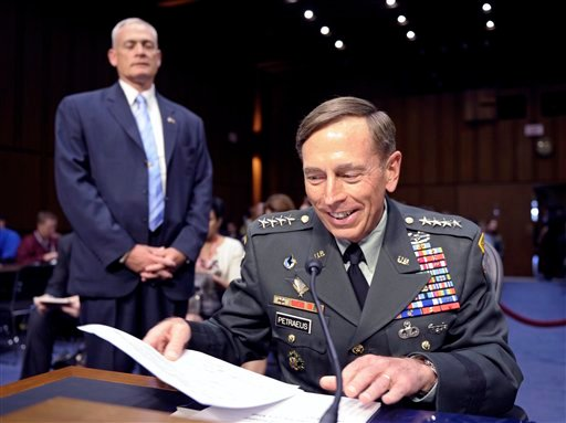 CIA Director nominee Gen. David Petraeus looks through his notes on Capitol Hill in Washington, Thursday,June 23, 2011, prior to testifying before the Senate Intelligence Committee hearing on his nomination.