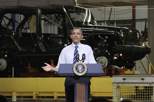 FILE - In this June 3, 2011 file photo, President Barack Obama speaks in front of a Jeep Wrangler at Chrysler Group's Toledo Assembly complex in Toledo, Ohio.