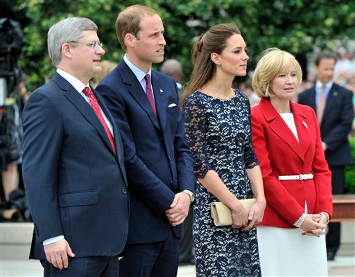 Prince William and Kate, the Duke and Duchess of Cambridge and Canada Prime Minister Stephen Harper and his wife Laureen pause at the War Memorial in Ottawa, Canada, on their first official overseas trip Thursday, June 30, 2011