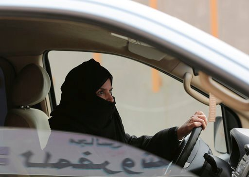 FILE - In this Saturday, March 29, 2014 file photo, Aziza Yousef drives a car on a highway in Riyadh, Saudi Arabia, as part of a campaign to defy Saudi Arabia's ban on women driving. (AP Photo/Hasan Jamali, File)