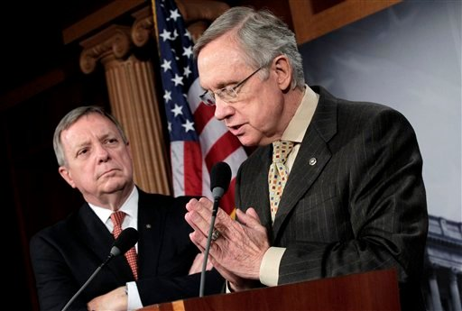 Insisting there is too much to do for lawmakers to spend a week away from the Capitol, Senate Majority Leader Harry Reid of Nev., right, accompanied by Senate Majority Whip Richard Durbin of Ill., speaks to reporters on Capitol Hill in Washington (AP)