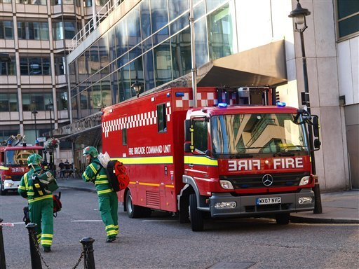 The fire brigade attend the scene as around 1,500 people were forced to leave the Hilton on Park Lane, London, due to a fire in a kitchen July 1, 2011. (AP Photo/PA, Max Nash)