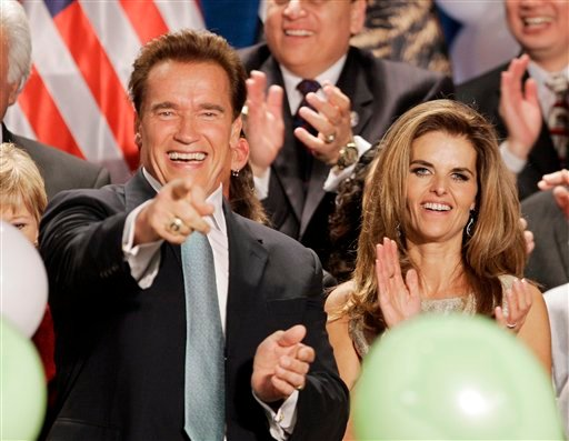 FILE - In this Nov. 6, 2006 file photo, Gov. Arnold Schwarzenegger celebrates with his wife Maria Shriver after giving his acceptance speech, in Beverly Hills, Calif.
