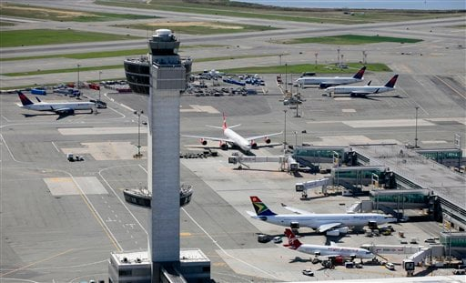 FILE - In this April 20, 2010 file aerial photo, the air traffic control tower and terminals at John F. Kennedy International Airport are shown in New York.