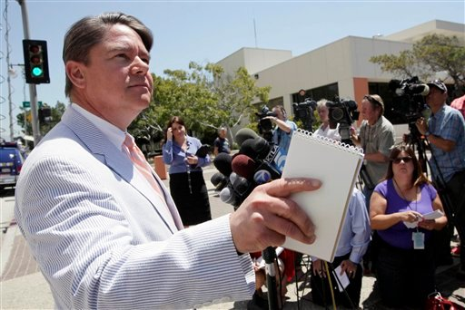 Thom Mrozek spokesman for the U.S. Department for Justice speaks to media Friday July 1, 2011 in Los Angeles, after a hearing for Oluwaseun Noib,i a Nigerian man who allegedly breached airport security and boarded a cross-country Virgin America flight.