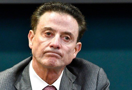 Louisville coach Rick Pitino reacts to a question during an NCAA college basketball press conference in Louisville, Ky.