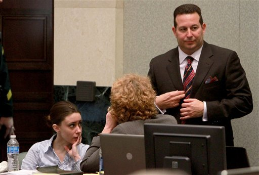 Casey Anthony with her attorneys Jose Baez, standing, and Dorothy Clay Sims, waits for the jury to come back for final instructions before beginning deliberations in Anthony's murder trial July 4, 2011. (AP Photo/Joe Burbank, Pool)