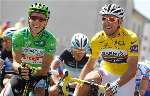 Thor Hushovd of Norway, wearing the overall leader's yellow jersey, right, and Philippe Gilbert of Belgium, wearing the best sprinter's green jersey, left, wait to take the start of the third stage of the Tour de France cycling race over 198 kilometers.