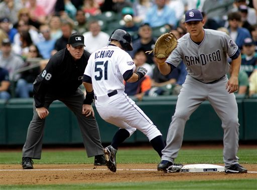 Seattle Mariners' Ichiro Suzuki (51) tags up before San Diego Padres first baseman Anthony Rizzo can catch the pick-off attempt in the first inning of an interleague baseball game July 3, 2011, in Seattle. (AP Photo/Ted S. Warren)