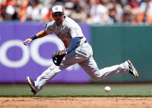San Diego Padres shortstop Jason Bartlett (8) makes the stop on a grounder by San Francisco Giants' Emmanuel Burriss during the first inning of a baseball game, Monday July 4, 2011, in San Francisco. (AP Photo/Tony Avelar)