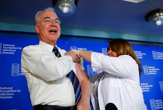 Health and Human Services Secretary Tom Price, left, receives a flu vaccination from Sharon Walsh-Bonadies, RN.