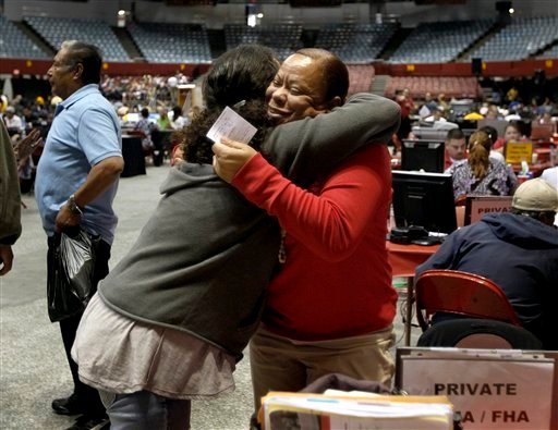 Vicky F., right, a Bank of America loan advisor, and Yanelin Ramon of Los Angeles embrace as hundreds of mortgage holders seek to have their high-interest loans, sometimes for more than their homes are worth, modified.