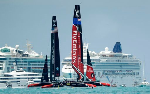 Emirates Team New Zealand, right, races Oracle Team USA during the ninth race of the America's Cup sailing competition Monday, June 26, 2017, in Hamilton, Bermuda. (AP Photo/Gregory Bull)