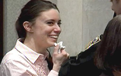 In this image made from video, Casey Anthony smiles as she returns to the defense table after being acquitted of murder charges at the Orange County Courthouse in Orlando, Fla. July 5, 2011. (AP Photo/Pool)