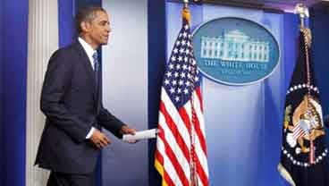 President Barack Obama arrives in the James Brady Press Briefing Room of the White House in Washington, Tuesday, July 5, 2011, to make a statement to reporters about debt ceiling negotiations. (AP Photo/Manuel Balce Ceneta)