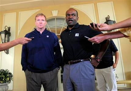 NFL commissioner Roger Goodell, left, and National Football League Players Association executive director DeMaurice Smith speak to the media after addressing players during the NFLPA rookie symposium June 29, 2011 in Sarasota, Fla. (AP Photo/Brian Blanco)