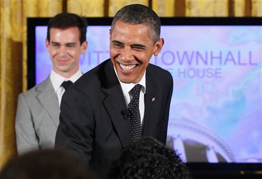 "President Barack Obama greets audience members accompanied by Twitter co-founder and Executive Chairman Jack Dorsey, during a ""Twitter Town Hall"" in the East Room of the White House in Washington, Wednesday, July 6, 2011."