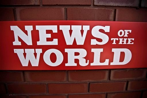 A News of the World sign is seen by an entrance to a News International building in London, Wednesday, July 6, 2011.