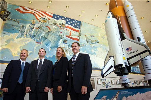 June 30, 2011 photo: the crew of STS-135, from left, pilot Doug Hurley, commander Chris Ferguson, mission specialist Sandy Magnus and mission specialist Rex Walheim at the Johnson Space Center, in Houston. (AP Photo/Houston Chronicle, Smiley N. Pool)