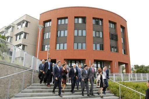 Gov. Jerry Brown walks with other elected officials to a bill signing to help address housing needs Friday, Sept. 29, 2017, in San Francisco. (AP Photo/Eric Risberg)