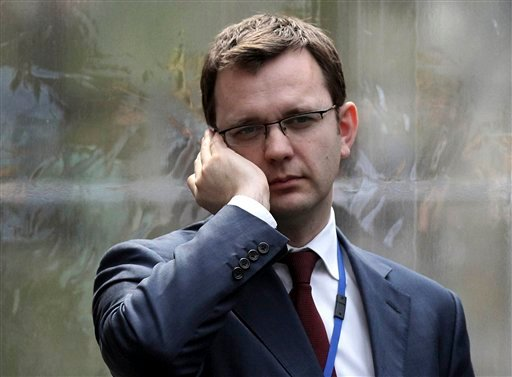 In this April 13, 2010 file photo, Andy Coulson, formerly editor of the tabloid News of the World, and later David Cameron's director of communications, speaks on a mobile phone in London. London police on Friday, July 8, 2011, arrested Andy Coulson (AP)