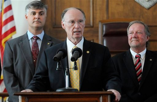 Alabama Gov. Robert Bentley sAlabama Gov. Robert Bentley is flanked by Sen. Scott Beason, R-Gardendale, left, and Micky Hammon, R-Decatur, right, as he speaks before signing into law what critics and supporters are calling the strongest bill in the nation
