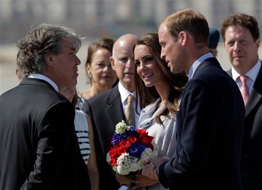 Prince William and Kate, the Duke and Duchess of Cambridge, talk to Canadian Consul General David Fransen, left, as they arrive at Los Angeles International Airport in Los Angeles, Friday, July 8, 2011.