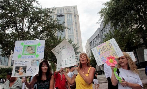 People dissatisfied with the the Casey Anthony verdict protest outside the Orange County Courthouse in Orlando, Fla., Thursday, July 7 2011.