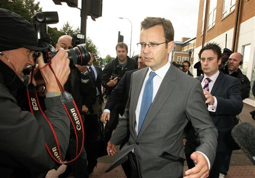 Former Downing Street communication chief Andy Coulson surrounded by media as he leaves Lewisham police station in south London, after being arrested in a phone hacking and police corruption scandal, Friday July 8, 2011.