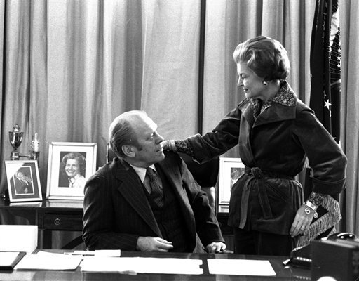 FILE - In this Jan. 19, 1977 file picture, President Gerald Ford and first lady Betty Ford pause for a moment as they continue packing at the White House in Washington.