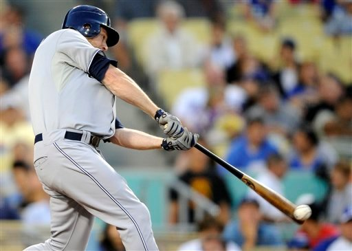 San Diego Padres' Chase Headley hits for double to right in the fourth inning of a baseball game against the Los Angeles Dodgers, Friday, July 8, 2011, in Los Angeles. (AP Photo/Gus Ruelas)