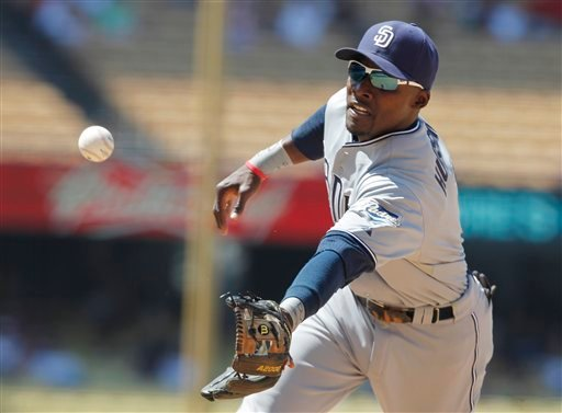 San Diego Padres second baseman Orlando Hudson flips the ball to first base for an out on the Dodgers' Rafael Furcal during the sixth inning of a baseball game, Saturday, July 9, 2011, in Los Angeles. (AP Photo/Christine Cotter)