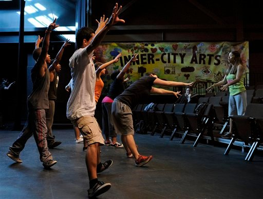In this June 30, 2011, photo, students rehearse at the Mark Taper Inner-City Arts academy, in the Skid Row section of Los Angeles. (AP)