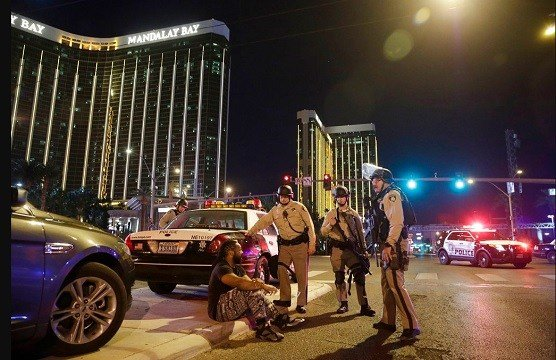 Officers stand at the scene of the shooting near the Mandalay Bay resort.
