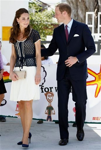 Prince William and his wife, Kate, the Duke and Duchess of Cambridge, leave an inner-city school in Los Angeles's notorious Skid Row area during the royal tour of California, Sunday, July 10, 2011.