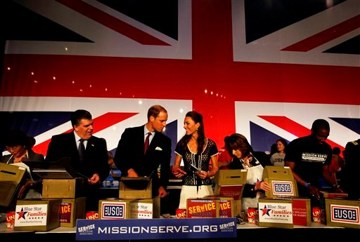 From left, Steven M. Missimer, the USO Vice President of Programs, Prince William, and his wife Kate, the Duke and Duchess of Cambridge, put together USO boxes at the Mission Serve Hiring Our Heroes job fair at Sony Studios in Culver City, Calif., Sunday.