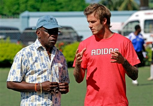 In this Sunday, Sept. 26, 2010 file photo, David Beckham, former England's soccer team captain and Los Angeles Galaxy midfielder, right, talks with Jack Warner, the vice-president of the International Federation of Football Association, FIFA.