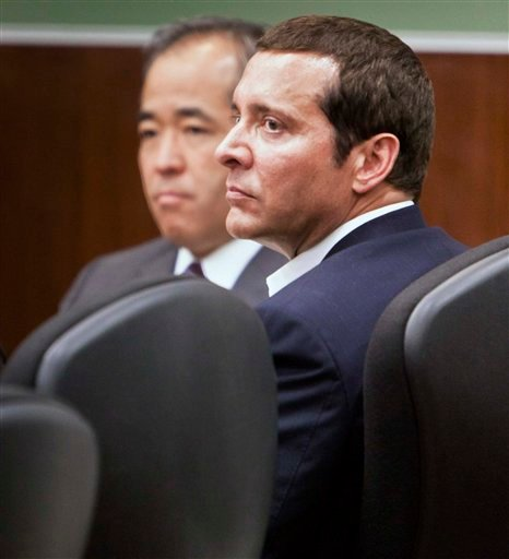 James Arthur Ray, right, listens along with attorney, Luis Li, during his trial, Wednesday, June 15, 2011 in Camp Verde, Ariz.
