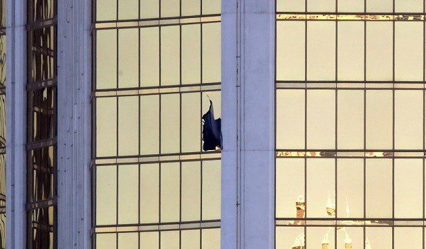 A broken window is seen at the Mandalay Bay resort and casino Monday, Oct. 2, 2017.
