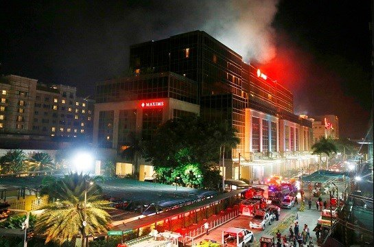 In this Friday, June 2, 2017, file photo, smoke rises from an attack inside the Resorts World Manila.