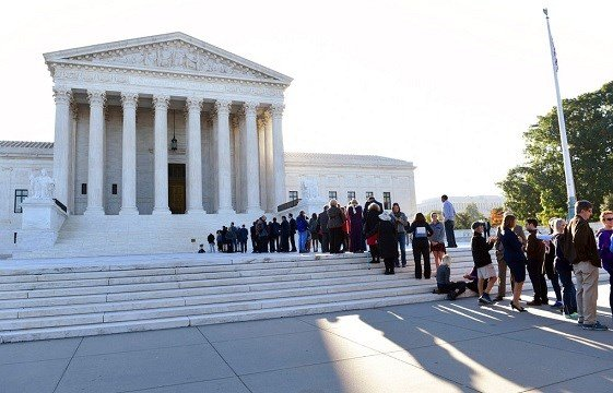 People stand in line to go into the Supreme Court in Washington, Monday, Oct. 2, 2017.