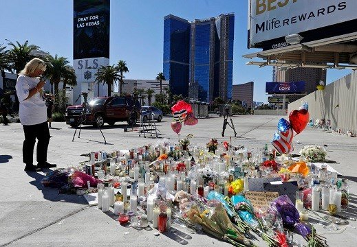 A woman looks over a makeshift memorial site on Las Vegas Boulevard on Tuesday, Oct. 3, 2017, in Las Vegas.