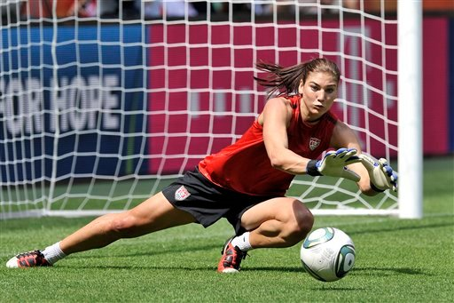 US goalkeeper Hope Solo stops a shot during the matchday –1 training of the United States on the eve of the semifinal match against France during the Women's Soccer World Cup in Moenchengladbach, Germany, Tuesday, July 12, 2011.