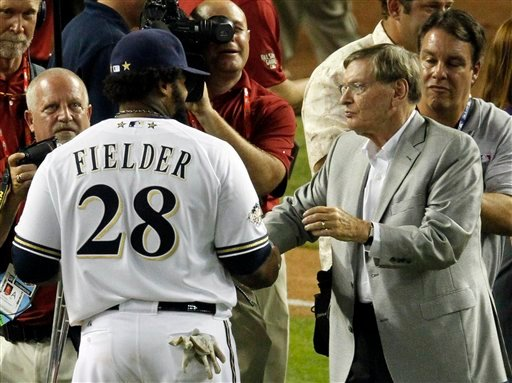 National League's Prince Fielder of the Milwaukee Brewers talks to commissioner Bud Selig after the MLB All-Star baseball game Tuesday, July 12, 2011, in Phoenix. The National League won 5-1. Fielder was named the game's MVP.